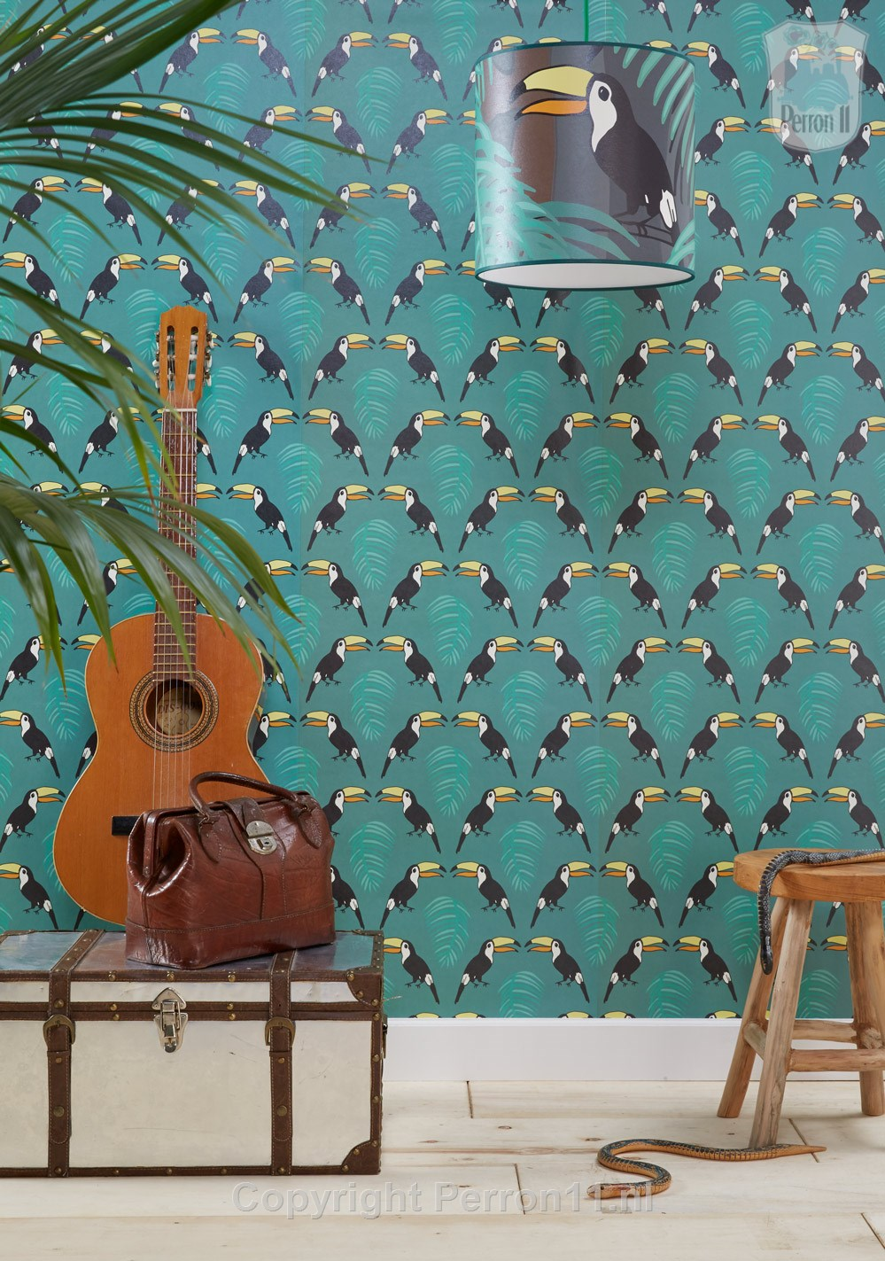jungle wallpaper toucan with wooden furniture and leather suitcases